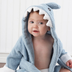A picture of a baby boy wearing a funky animal themed baby dressing gown
