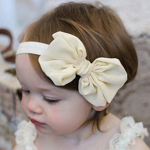 Image of a baby wearing a fabulous bow baby headband