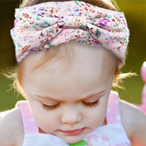 Image of a baby girl wearing a retro vintage baby headwrap