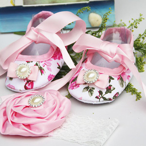 Image of a floral and ivory party shoe accompanied by a baby headband.